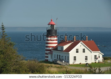 The candy striped west quoddy lighthouse on the atlantic ocean in Northern Maine