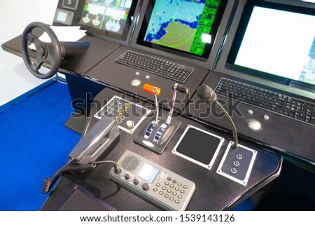 The captain bridge of the ship. Equipment to control the vehicle. Simulator for sailors. Navigational instruments on the captain bridge. Ship control.