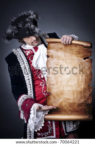 The captain with an old paper in hands - stock photo