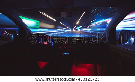 The car drive against the background of night light