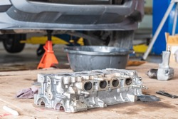 The car engine part of cylinder block was removed from a car for fixing or repairing.