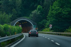 The car enters the road tunnel on a Italian highway
