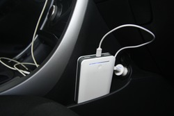 The car is charging the power bank from the usb socket. car interior