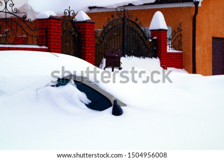 The car is covered in snow after heavy snowfall. Seasons. #1504956008