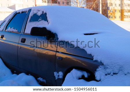 The car is covered in snow after heavy snowfall. Seasons. #1504956011