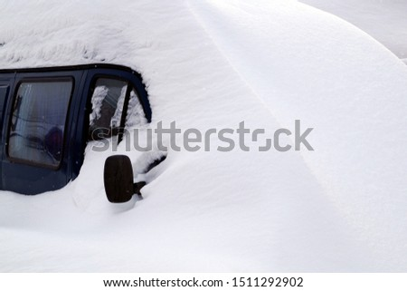 The car is covered in snow after heavy snowfall. Seasons. #1511292902