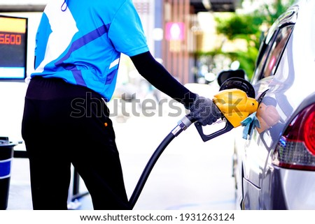 The car is refueling at the gas station. Сток-фото ©