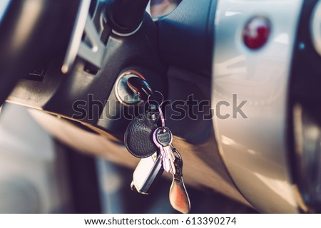 The car keys in the ignition lock. Warm toned picture, vintage tone.