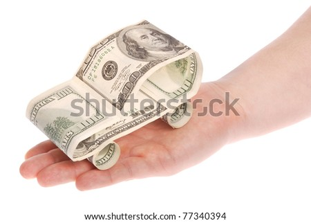 The car made of dollars on hand. Isolated on white. Clipping path included.