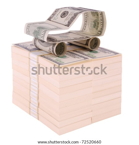 The car made of dollars. On packs of dollars. Isolated on white