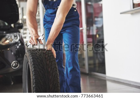 the car mechanic is preparing to replace the tires. Replacement of summer and winter tires. #773663461