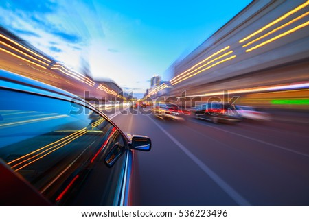 The car moves at fast speed at the night. Blured road with lights with car on high speed. #536223496