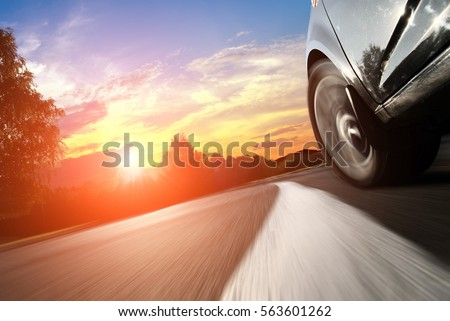 The car moves at fast speed at the night. Blured road with lights with car on high speed