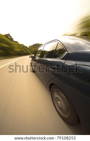 The car moves at great speed at the mountain road #79108255