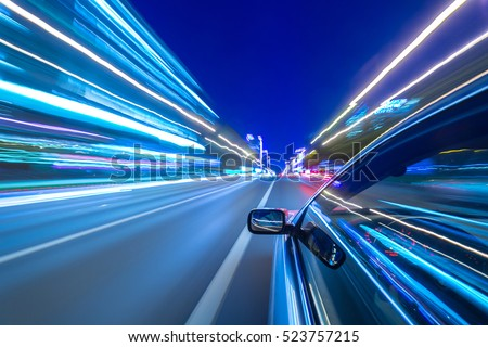 The car moves at great speed at the night. Cold color images.