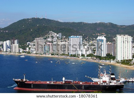 The cargo ship with Acapulco downtown in a background (Mexico).
