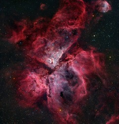 The Carina Nebula is a large, complex area of bright and dark nebulosity in the constellation Carina.