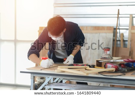 the carpenter working in the working space
