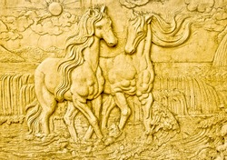 The Carving sandstone of horse. This is traditional and generic style in Thailand. No any trademark or restrict matter in this photo.