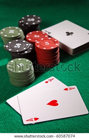 The casino scene. Poker playing cards on the table.
