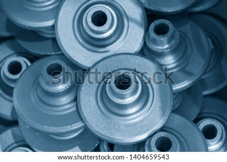 The casting iron parts in the light blue scene. The products of die casting process.