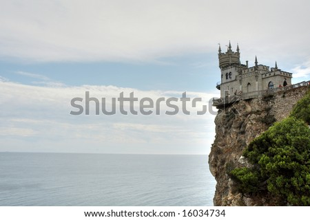 The castle in the Gothic style on impregnable cliff above the sea