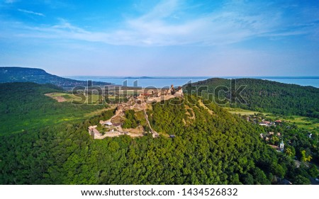 The Castle of Szigliget with Badacsony mountain and Lake Balaton in the background Stock photo ©