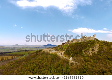 The Castle of Szigliget with Badacsony mountain next to lake Balaton in Hungary. Hisorical monument fortress ruins. Built was in 11 century, destroyed in 16. Stock photo ©