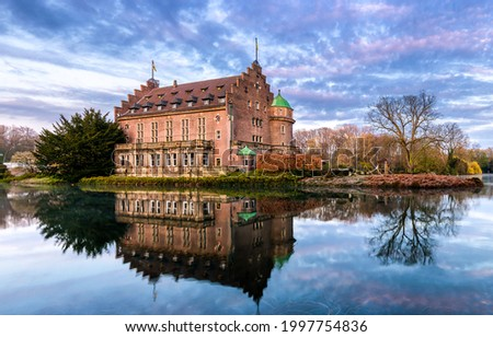 The castle on the lake shore. Castle manor house on lake. Castle lake water reflection. Castle on water