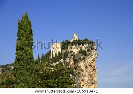 The castle ruin of Arco, on a steep cliff, near Lake Garda, Trentino province, Italy
