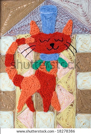 The cat a picture from a fabric a wool, is pasted on plywood.