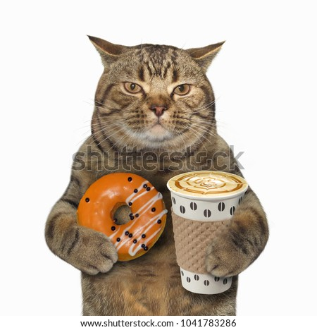 The cat holds a cup of coffee and orange glazed donut. White background.