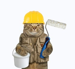 The cat worker in a yellow helmet and a construction vest is holding a plastic tin of paint and a roller brush. White background. Isolated.