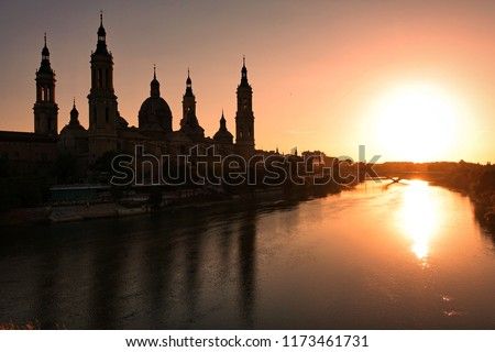 The Cathedral-Basilica of Our Lady of the Pillar and Ebor River at Sunset #1173461731