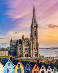 The Cathedral Church of St Colman, is a Roman Catholic cathedral in Cobh, Ireland. It overlooks Cork harbour. Construction began in 1868. The houses in front are know as Deck of Cards houses.