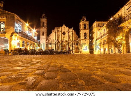 The Cathedral of Havana and its adjacent square and restaurant in the colonial neighborhood of Old Havana illuminated at night