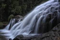 The Catherine waterfalls in Ooty Tamil Nadu India. Hidden amongst dense tea gardens, these famous cascading falls require a hike to access.