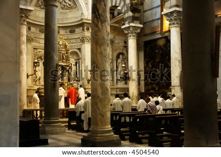 The Catholic priests inside the cathedral in Pisa on the field of miracles.