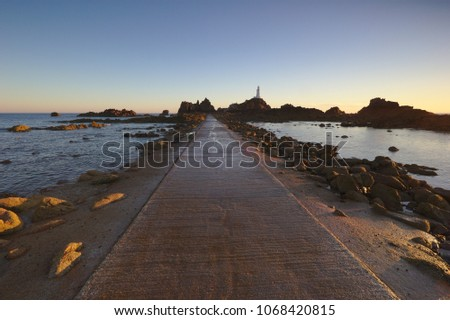 The causeway to Corbiere Lighthouse, Jersey, UK is only accessible at low tide.