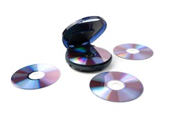 The CD player and old disks next to it are isolated on a white background. The concept of retro technology.