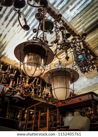 The ceiling of a treasure cove filled with antiques and historic elements for home decoration: an antique shop #1152405761