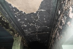 The ceiling of the building after the fire is all black.