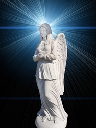 The cemetery monument in the form of an angel of white on a background of mystical rays, blue color.