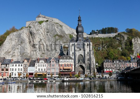 The center of the town of Dinant with the citadelle on the rock and Collegiate Church of Notre-Dame at the Meuse river