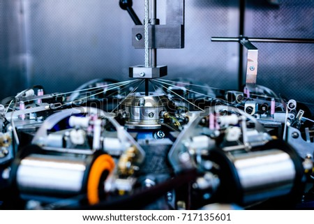 The central element of the mechanism of a vertical braiding machine. Foto stock ©