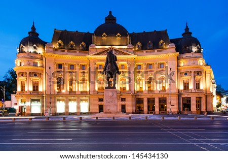 The Central University Library is located in central Bucharest with statue of Carol I, first king of Romania in front. Romania - stock photo