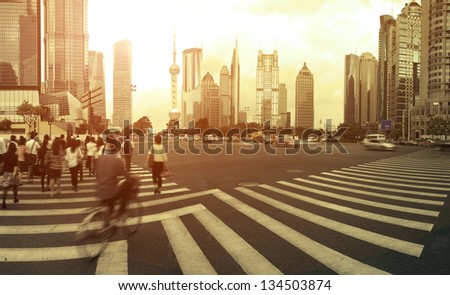 The century avenue of  street scene of people walking hurriedly in shanghai Lujiazui,China.