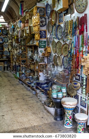 The ceramics dishes and souvenirs in the gift shop on market in Nazareth, Israel #673803820
