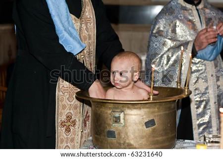 The ceremony of christening the little boy at church