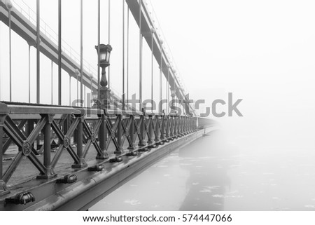 The Chain Bridge in Budapest in a foggy morning, Hungary. #574447066